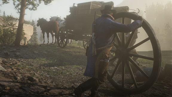 アーサーが馬車の車輪を直すシーン