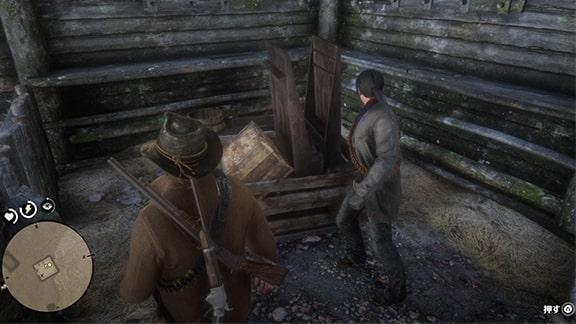 隠し金を探すため木箱を押すアーサーとハビア