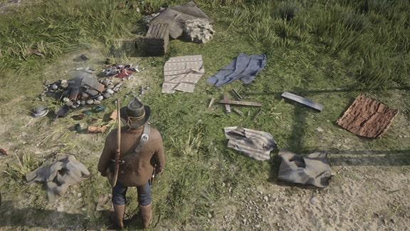 アーサーがテント跡を調べる光景