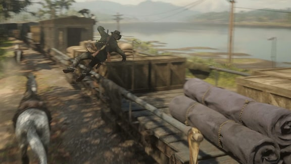 アーサーが軍の列車に飛び乗るシーン