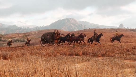 荒野を進む馬車と馬たちの風景