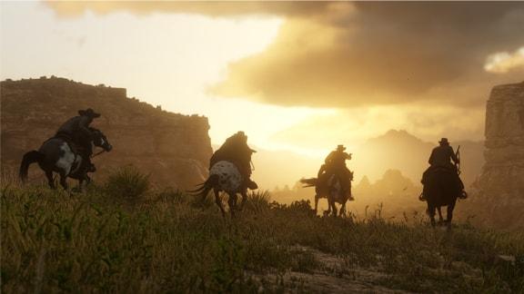 乗馬で荒野を駆け抜けてる画像