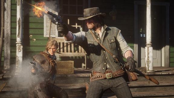 ジョン・マーストンと女性が銃で戦っている画像