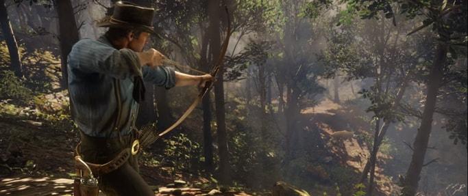 アーサーが弓を引いて、森にいる野生動物を狩ろうとしている画像