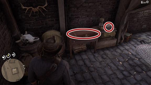 銃器職人を脅して地下を襲うシーン