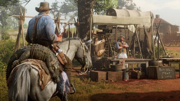 キャンプへ獲物を持ち帰る様子の画像
