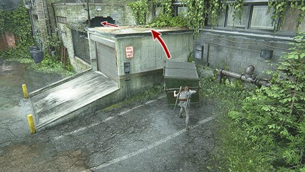 ゴミ箱を足場にシャッターの屋根へ上る様子